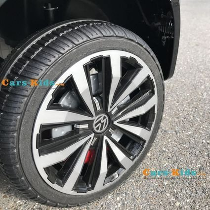 Электромобиль Volkswagen Amarok 4WD черный (2х местный, колеса резина, кресло кожа, пульт музыка)